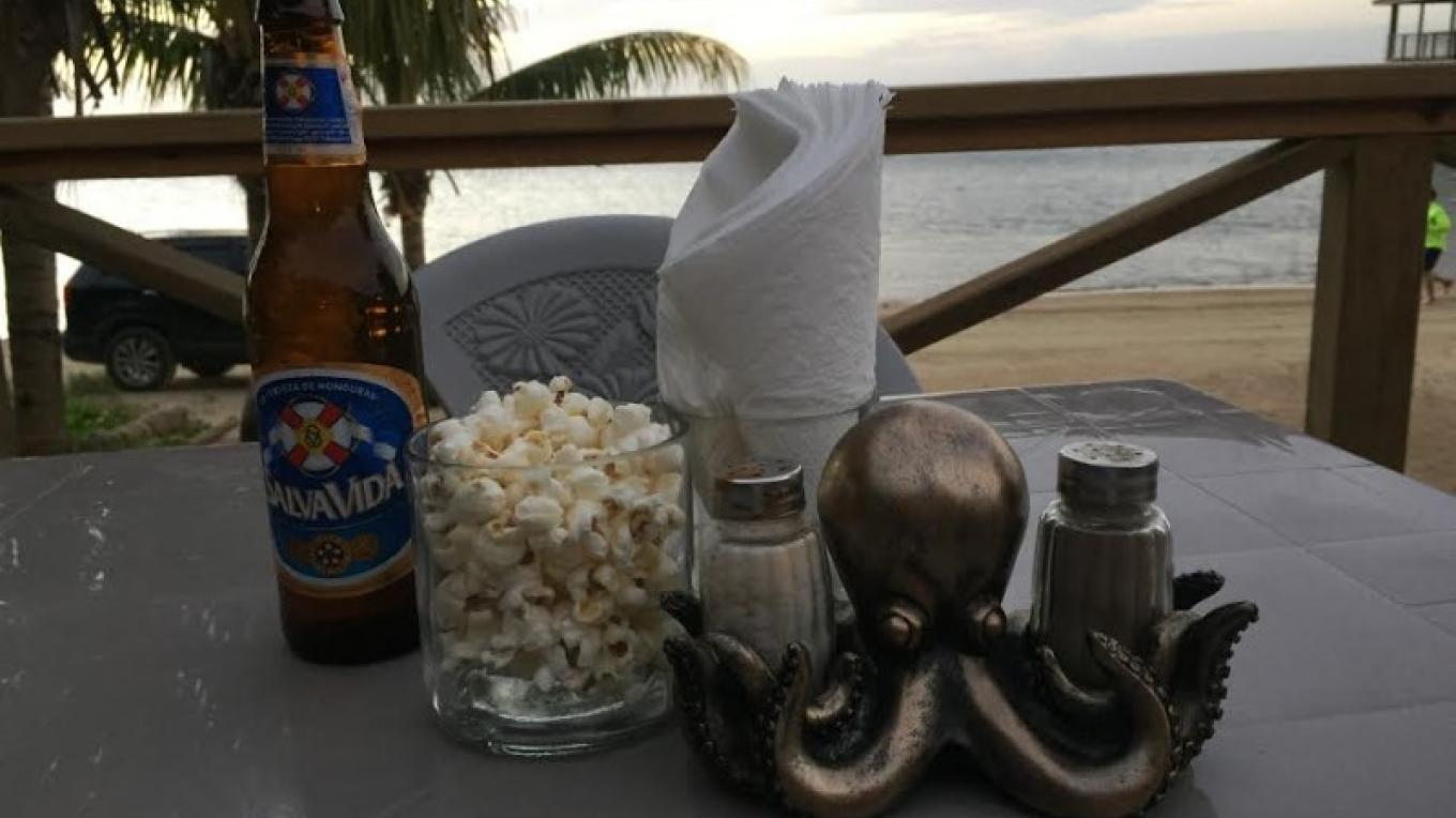 Free popcorn served in recycled bottles awaiting your visit at The Jolly Octopus