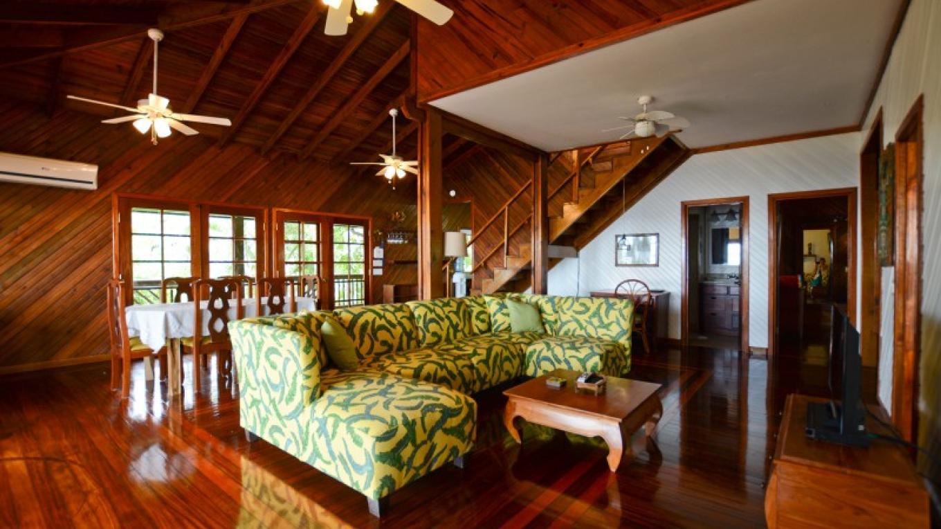 The living space in Annabel is in the traditional tropical island style. The deck wraps around the entire house shading the home from the sunshine. Open up the windows and doors and let the island breeze keep the home cool. – Ruth Healey-Elmore