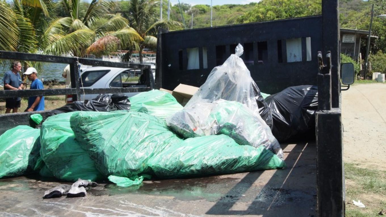 More garbage being picked up in Brick Bay. – Manlio Martinez