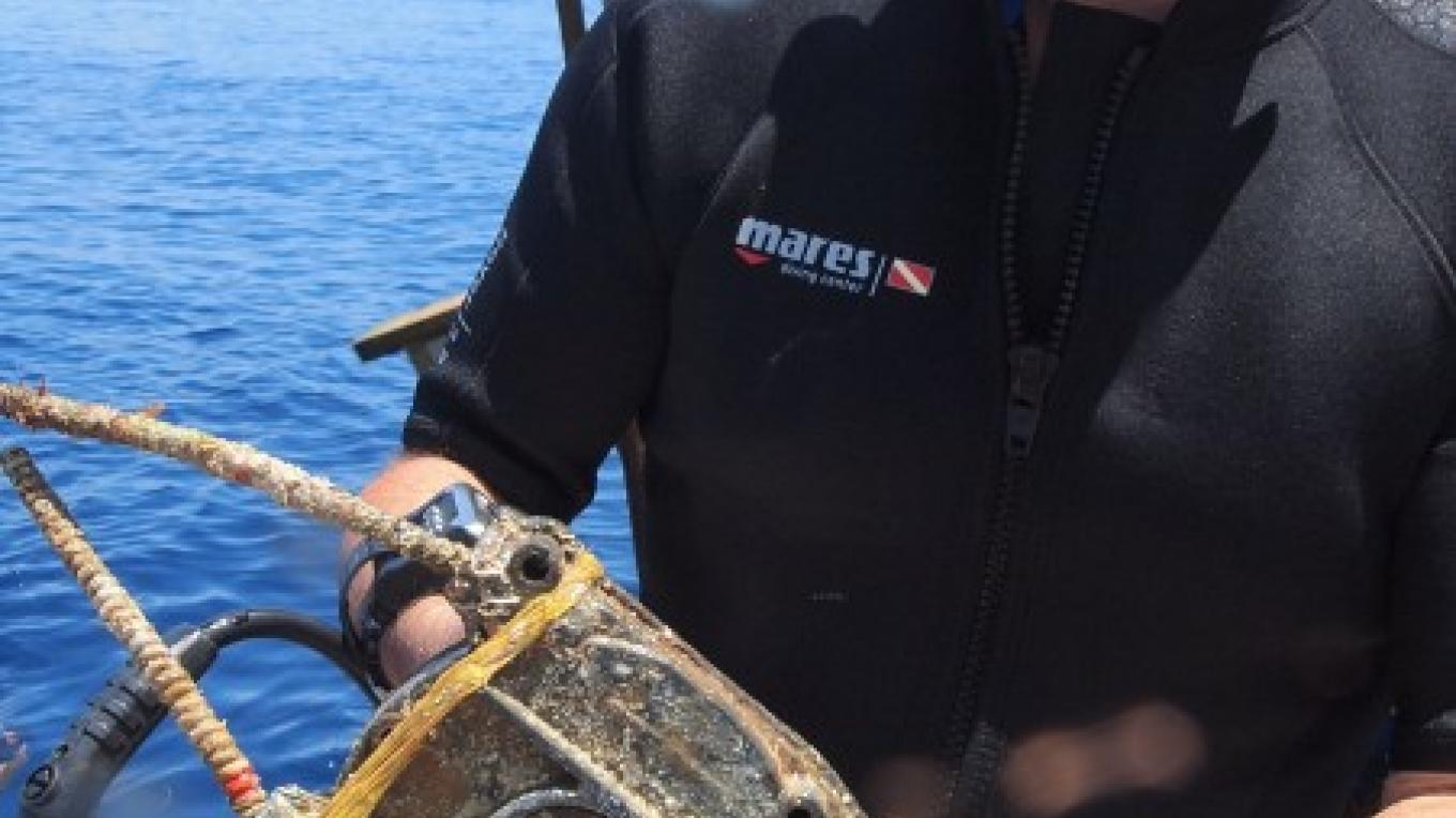 Motor parts removed from the sea floor. – Manlio Martinez