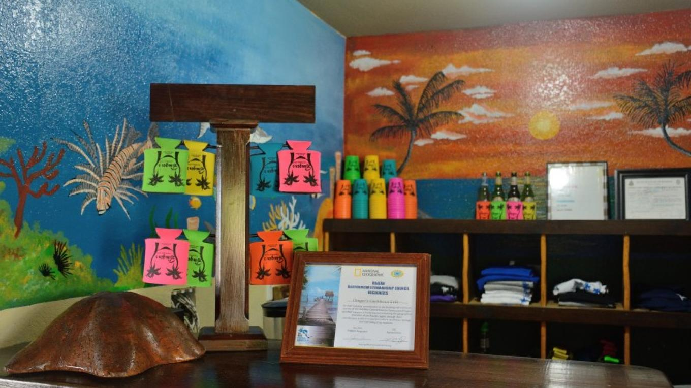 Our T-shirt shack has cups, koozies, T-shirts and more! – Manlio Martínez