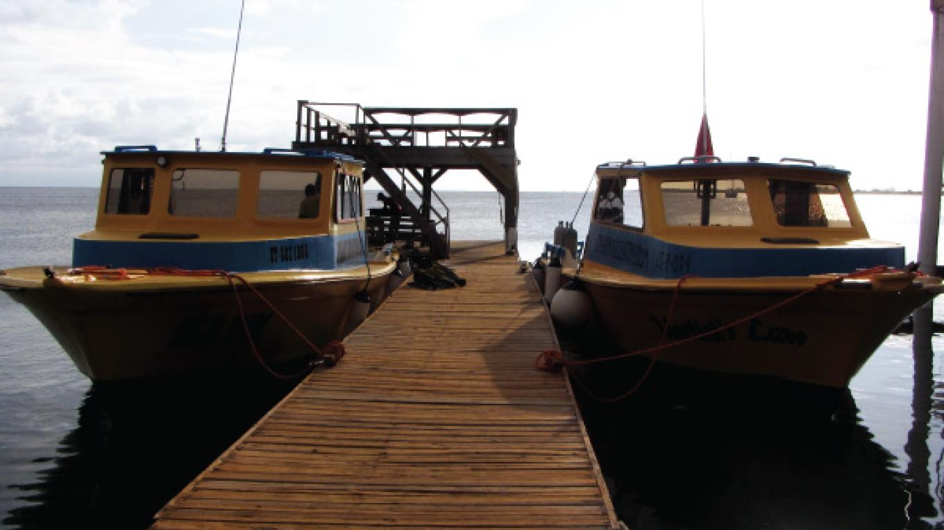 UDC dock and two of the boats from our five boat fleet. – Ash Kirkham