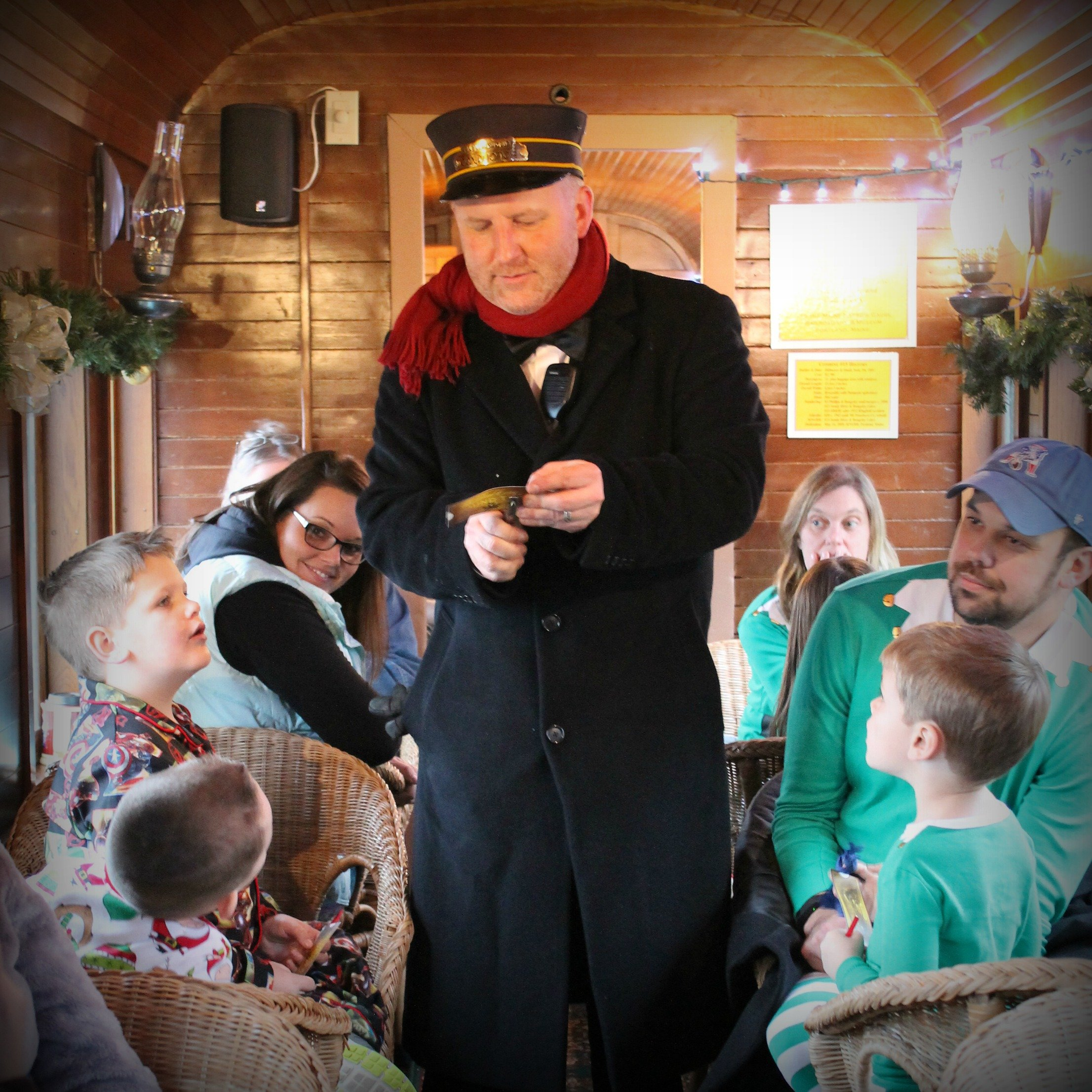 Conductor Wes Heinz punches tickets during the annual Polar Express™ holiday train ride.