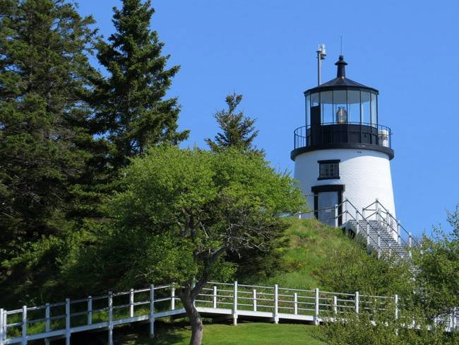 Enjoy sparkling views of Penobscot Bay and nearby islands during a climb up to lighthouse.