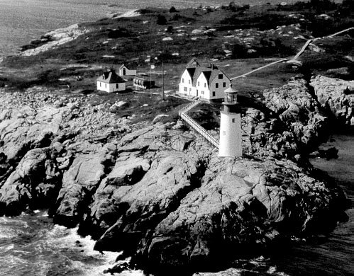 Historic photo of Moose Peak Light Station. Many of the buildings have been removed. The tower remains, which is automated.
