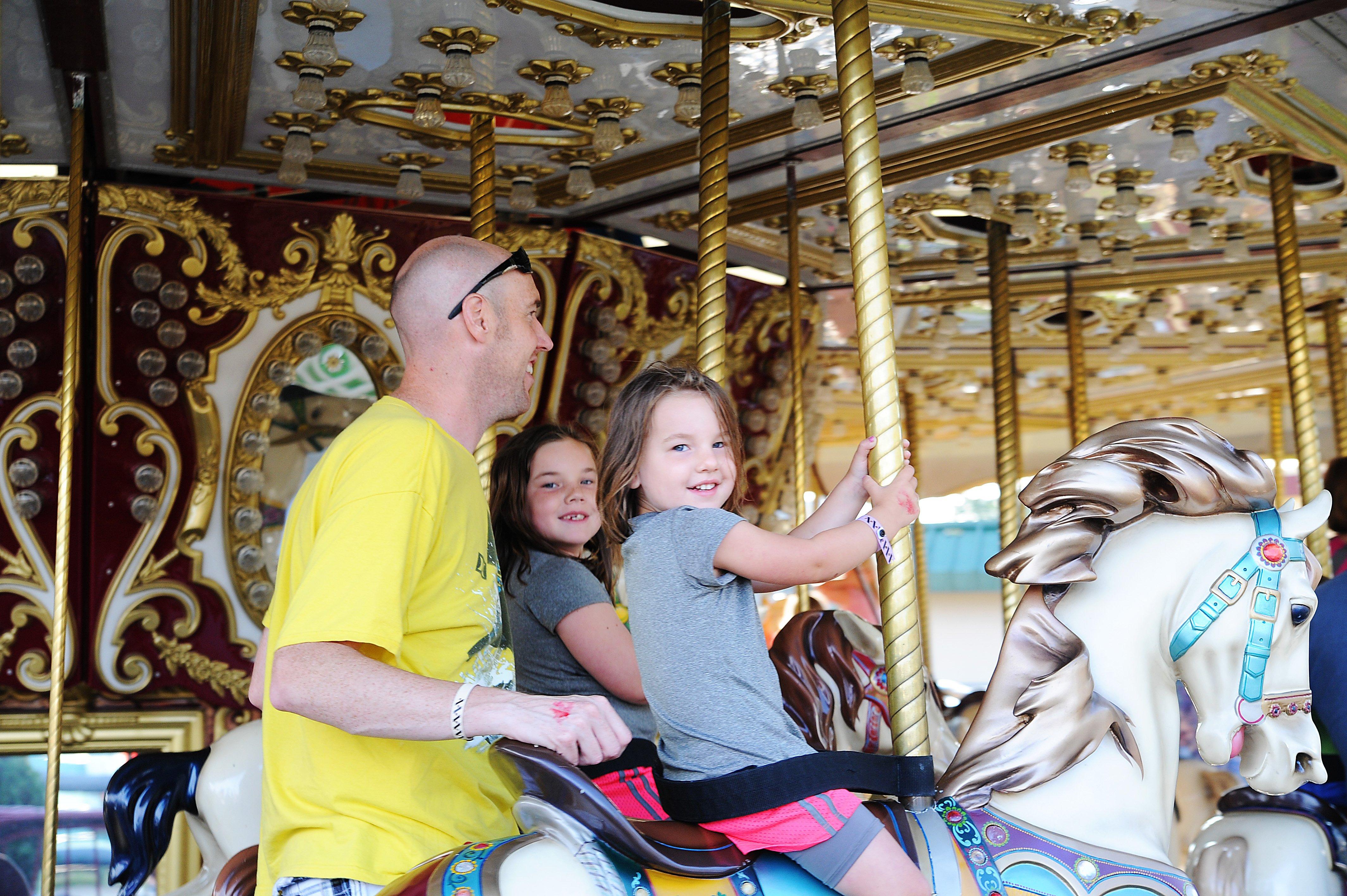 Families having fun on the Classic Carousel in Funtown USA Ride Park