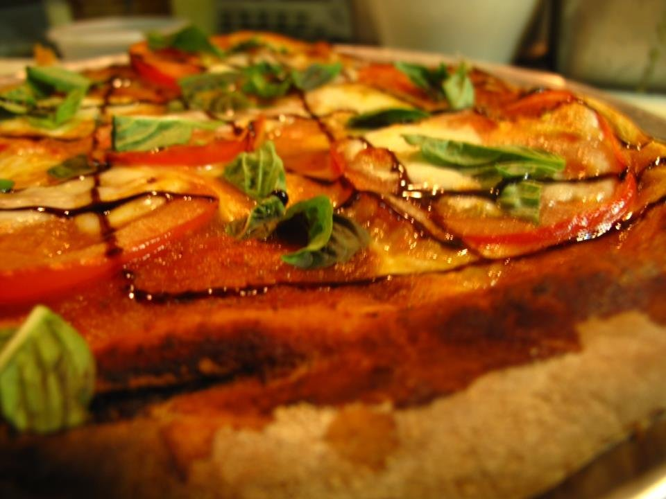 Wood Fired Tomato Basil Pizza with Fresh Mozzarella and a Balsamic Reduction