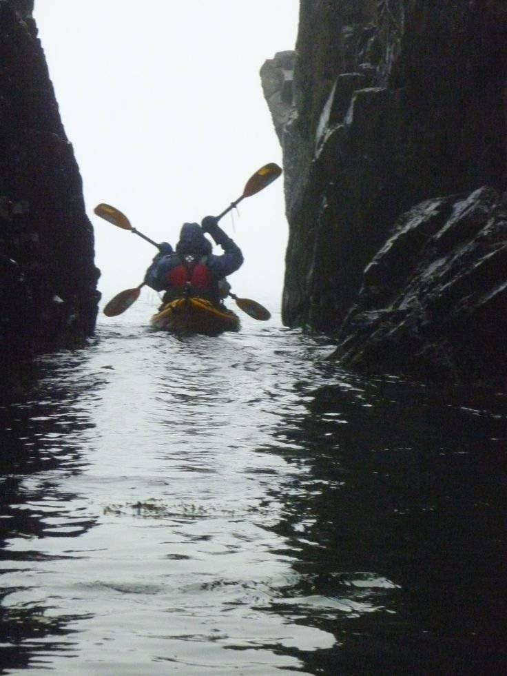 Kayaking out of a sea cave