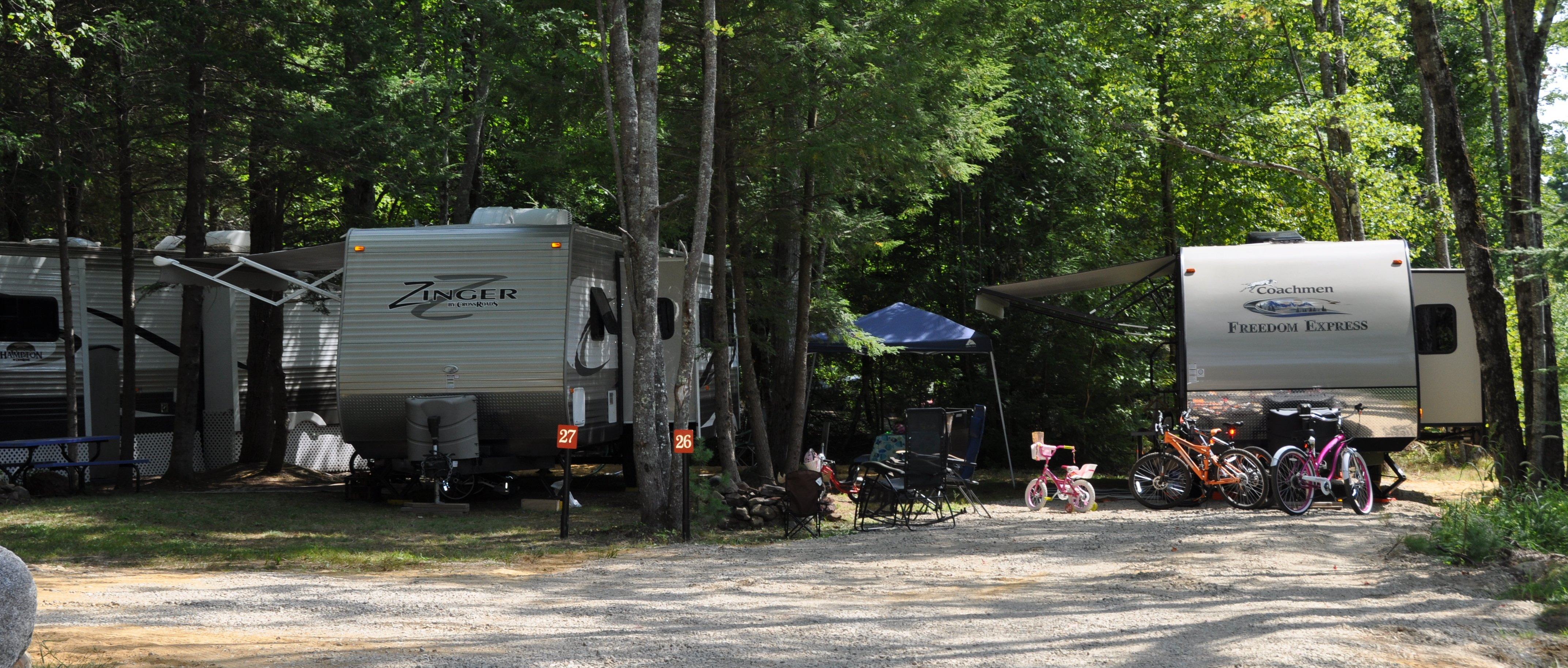 Spacious campsites accommodating basic tenting to RV's up to 42'. include picnic tables, fire pits and electricity.