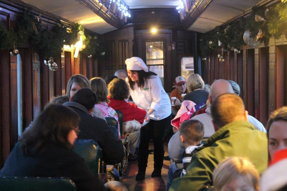 Chefs deliver hot chocolate to passengers aboard the train.