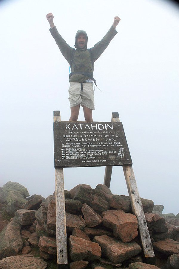 Man celebrating Mount Katahdin climb.
