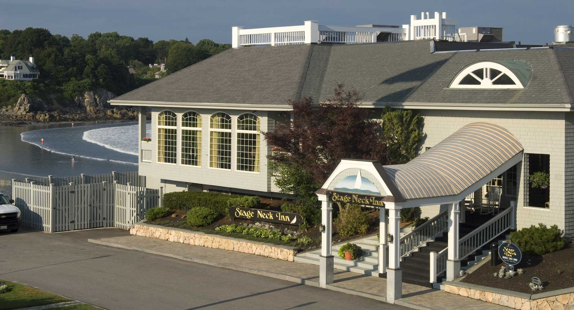 """Sandpipers is situated on a peninsula overlooking the beach and the """"summer cottages"""" that dot the shore. The small-group meeting space is within Stage Neck Inn"""
