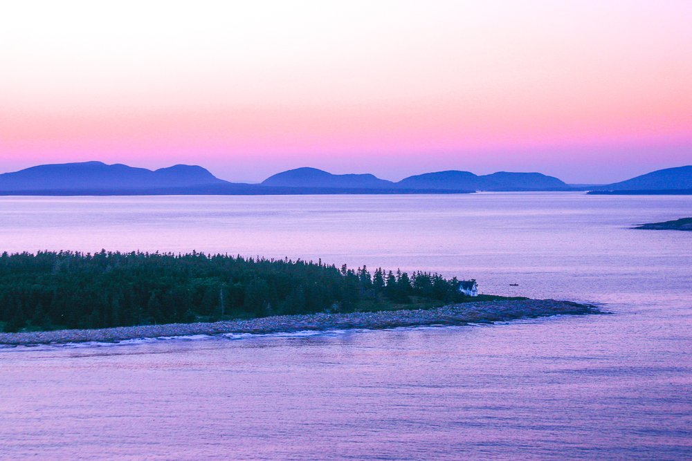 On the tip of the northeast point of Great Duck Island you can see our house. The mountains of Acadia National Park are in the distance.
