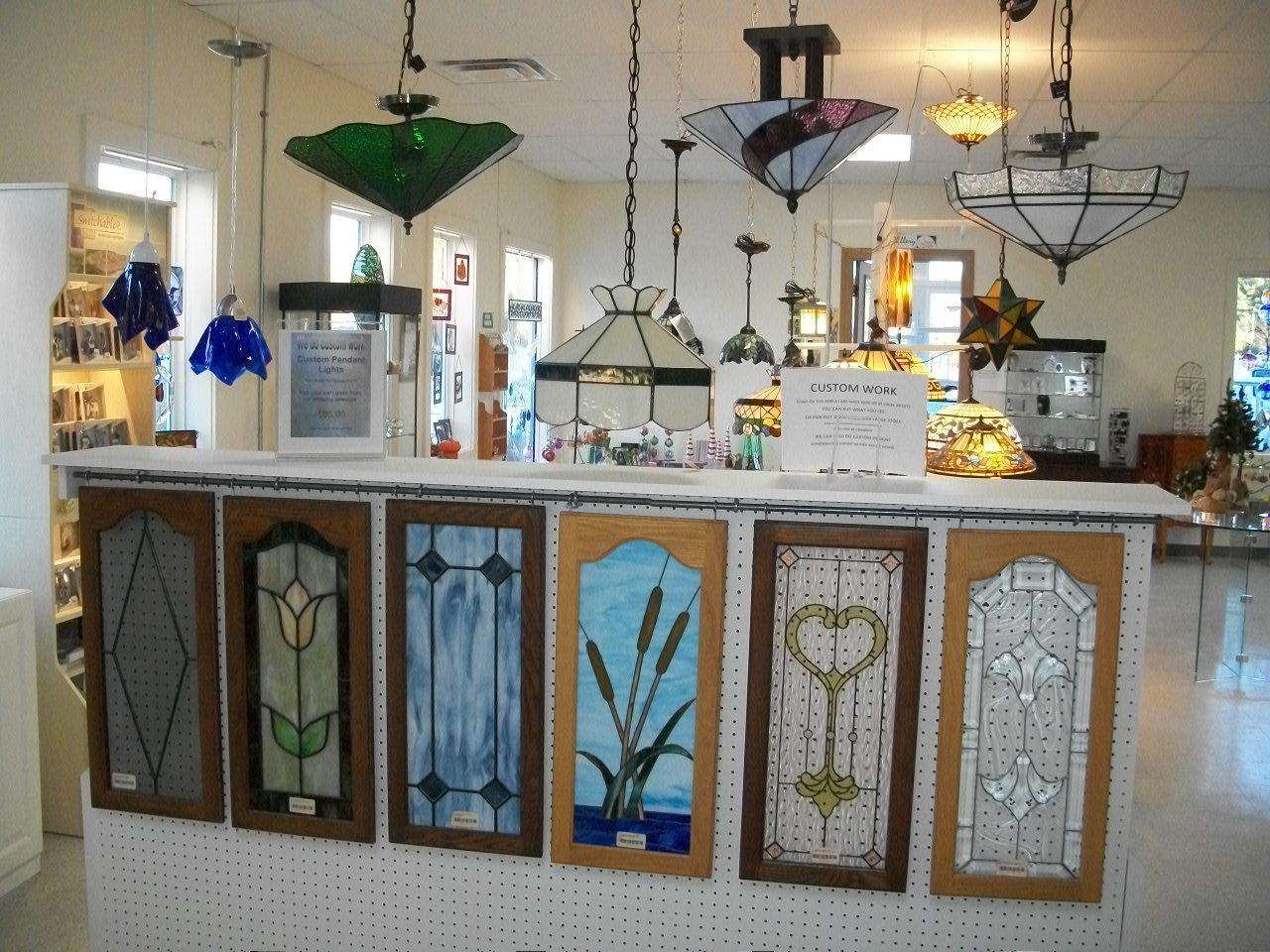 Custom stained glass lamps and cabinets display