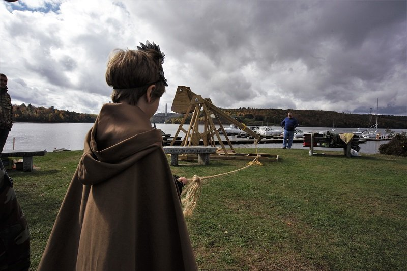 a Goblin at Ghostport launches a pumpkin in to the Penobscot by means of our trebuchet