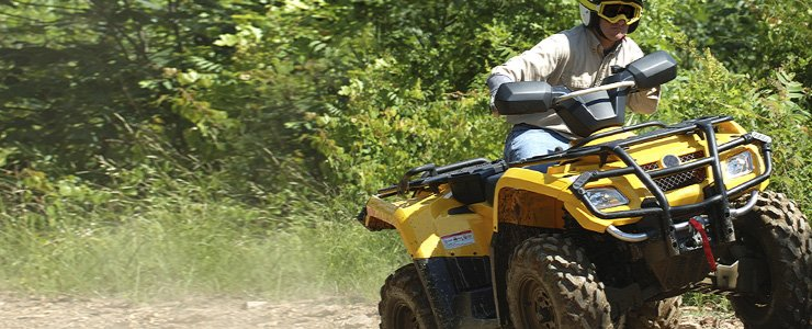 Man enjoying an ATV ride on one of Maine's trails.