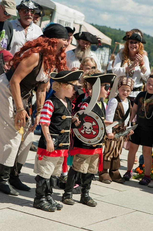 Little people doing their best pirate impersonations at the pirate festival, Fort Knox, Prospect Maine.