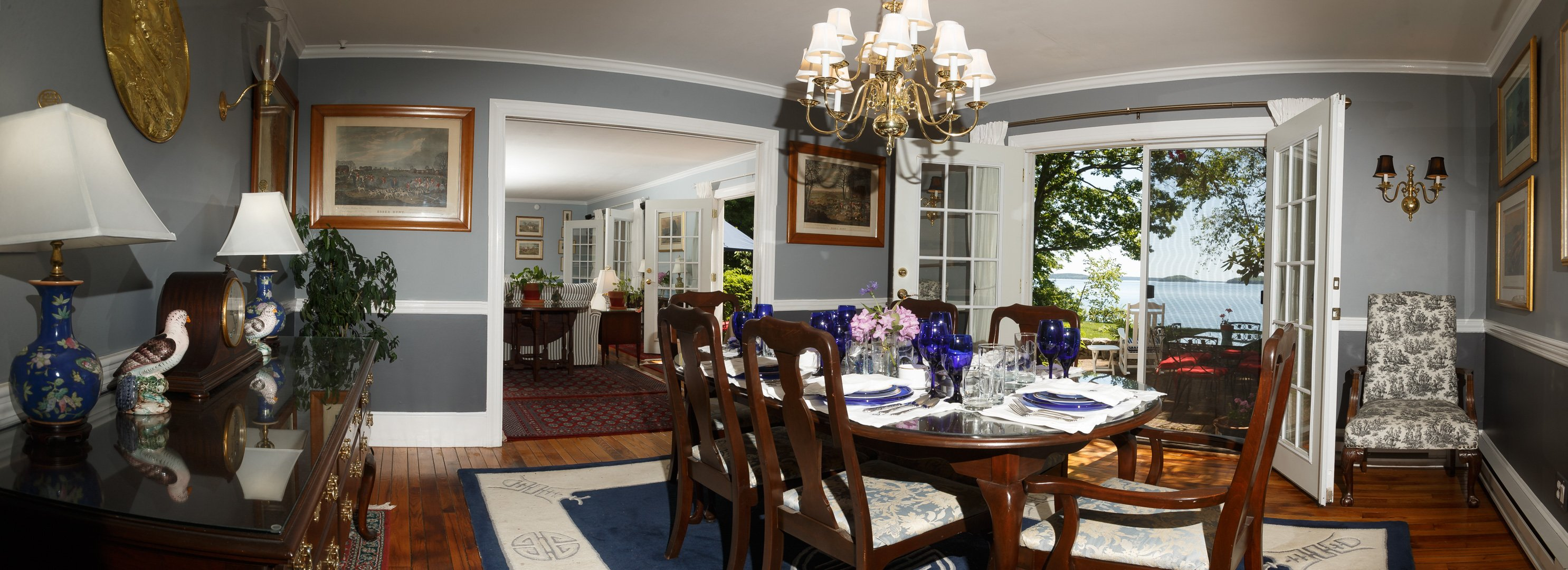 Formal dining room. Ocean view. French door to brick patio and outside dining. Stobart art. 200-year old English hunting prints. Antiques. Seats 8, plus 6 joined by table in living room.