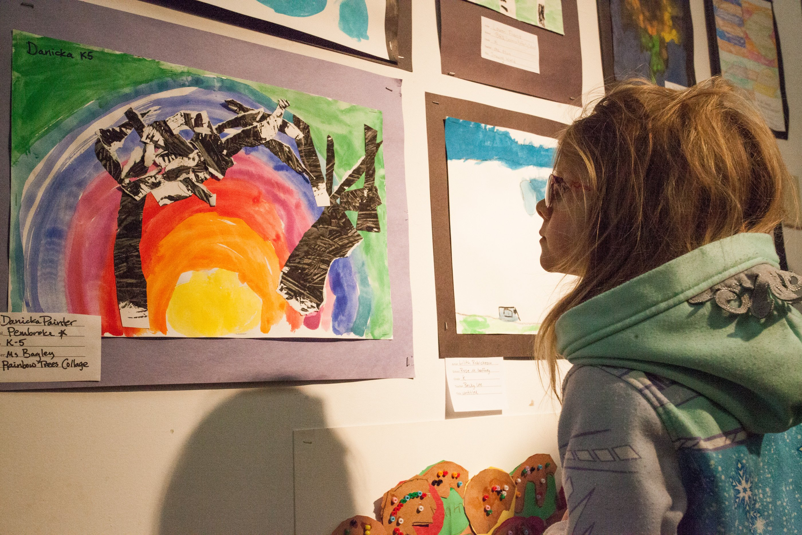 A young gallery goer enjoys her peers' artwork at Washington Street Gallery's annual Youth Art Month exhibition.