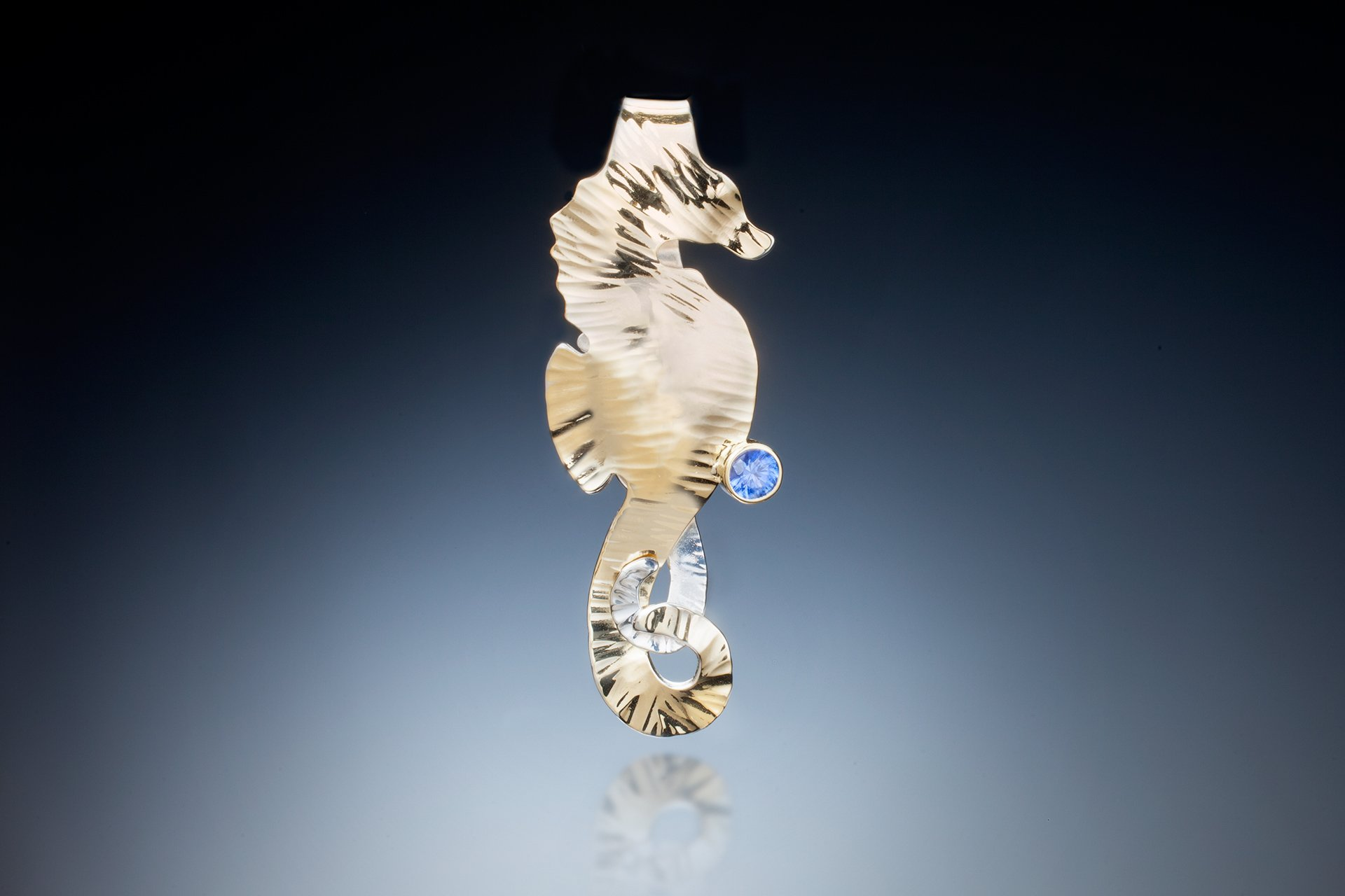 Handmade seahorse pendant with sapphire. Available in various sizes in gold and silver.
