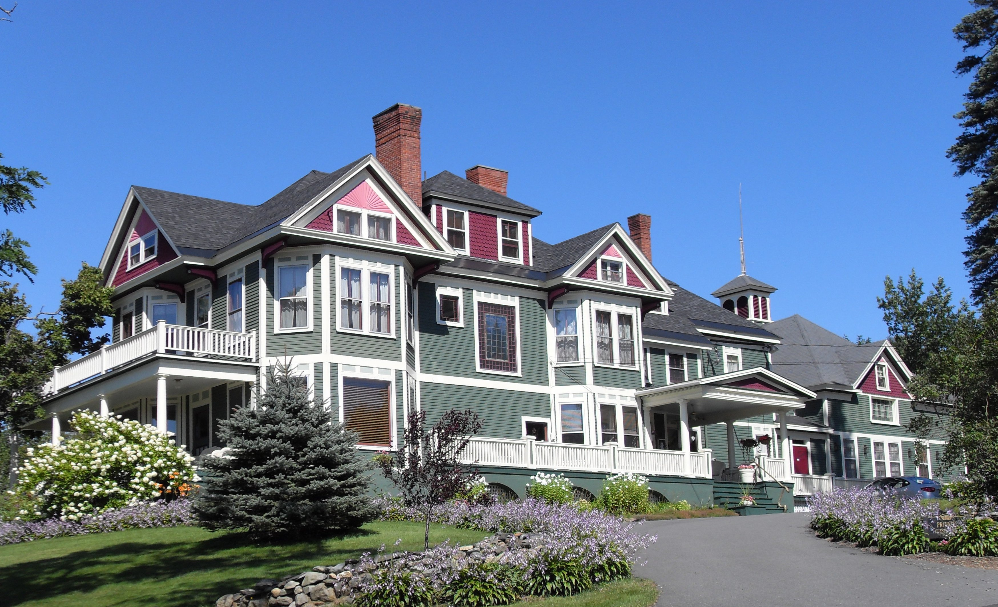 Historic Greenville Inn sits majestically overlooking Moosehead Lake, town of Greenville and Moose Mountain Range.