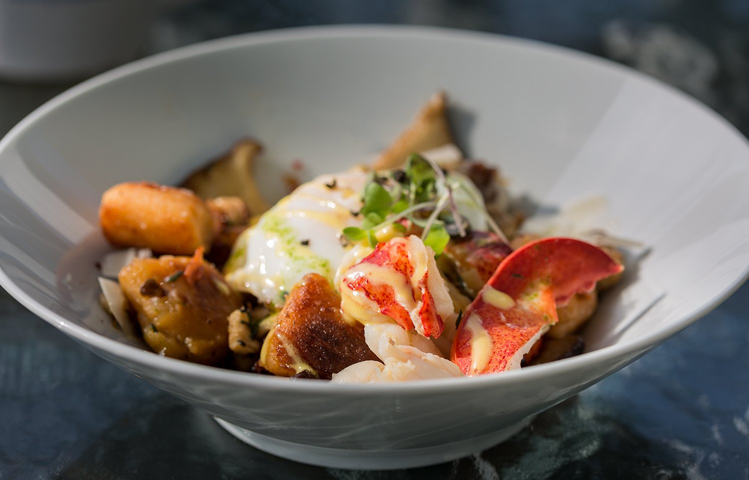 Homemade Gnocchi with champagne poached lobster, locally foraged mushrooms and a sunny side egg.
