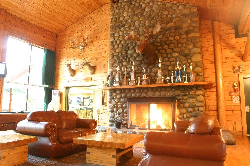 Soak in the outdoor giant hot tub or relax by the roaring fireplace back at Northern Outdoors resort after a great day of riding.