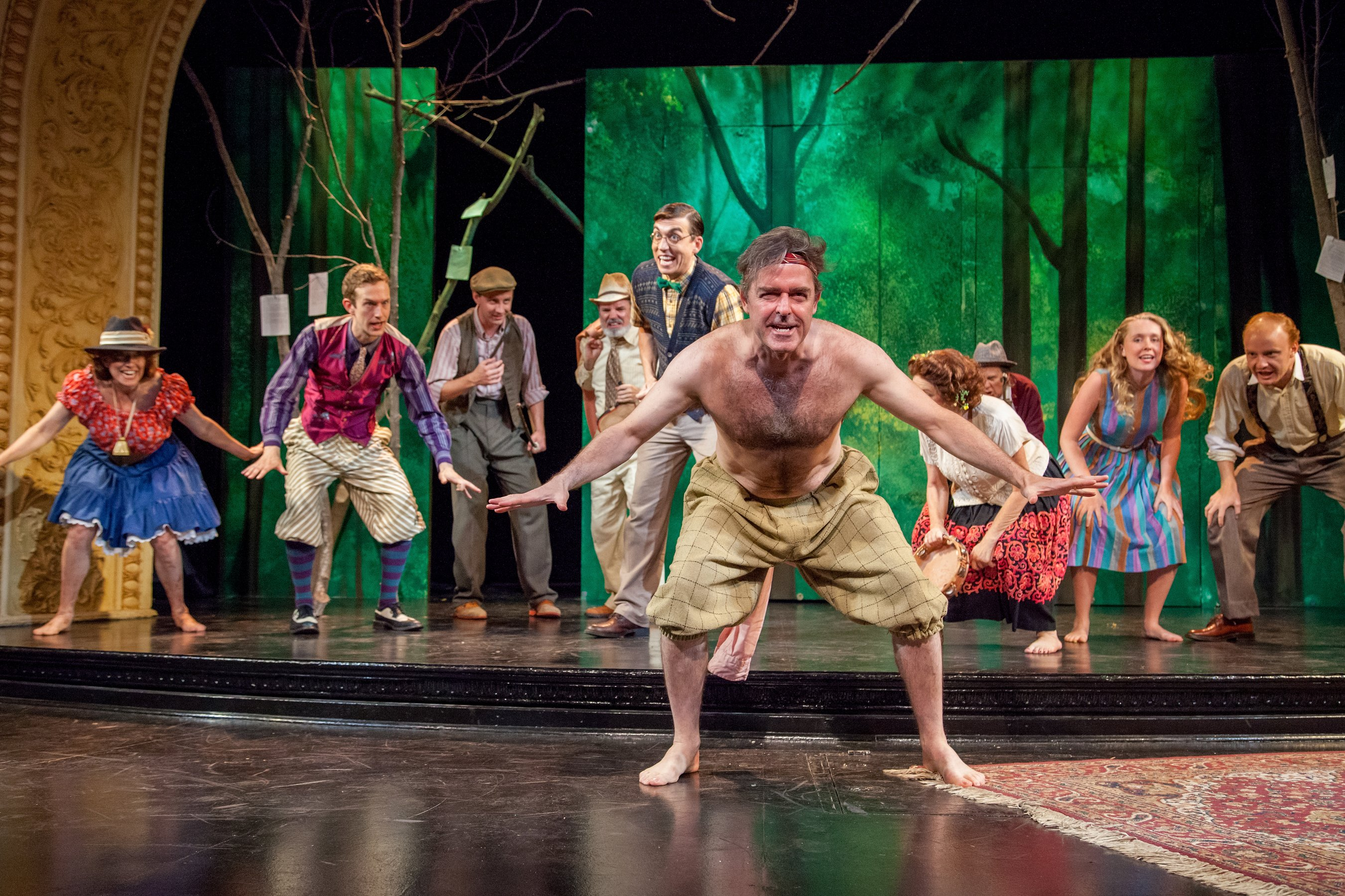 James Noel Hoban as Amiens and the cast of As You Like It from Theater at Monmouth's 2014 production of As You Like It. Directed by Catherine Weidner.