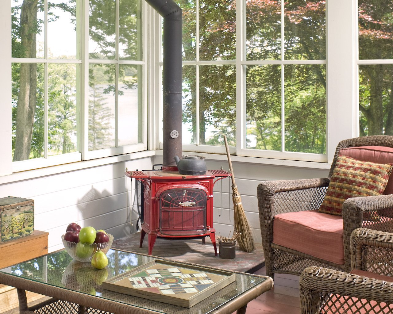 Newcastle Inn screened porch with views of gardens and Damariscotta River.