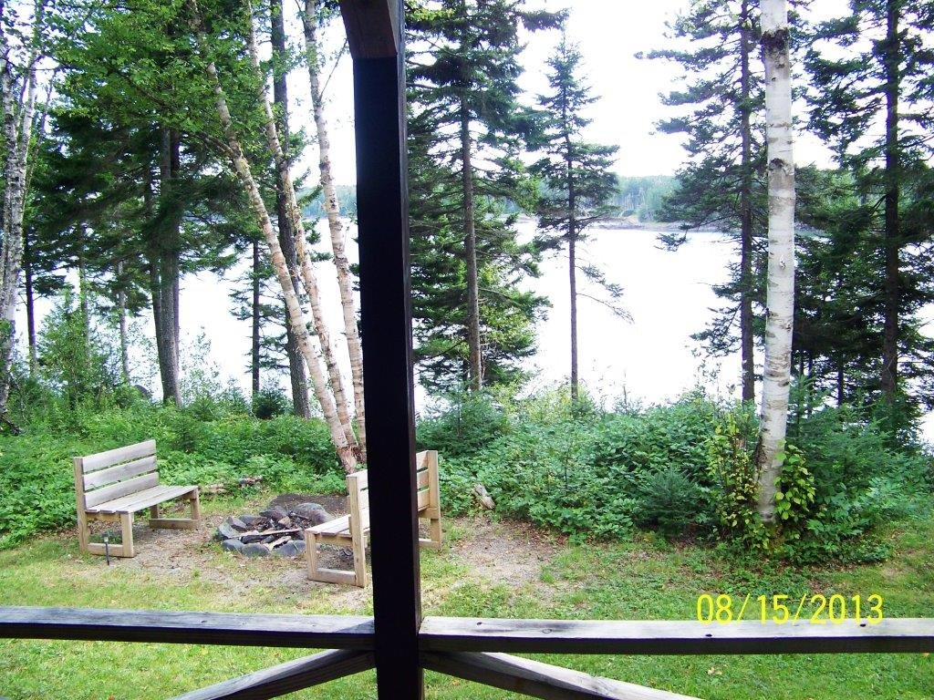 View of Trees and Ocean from Front Porch of Duck Cove Cottage