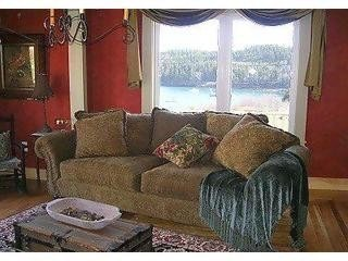 Cottage living room with a view of the harbor