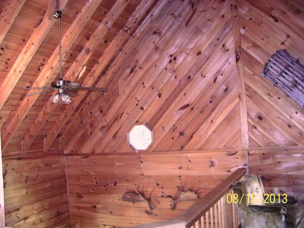 Open Loft Area with 37.5 foot Ceiling over Primary Living Room at Duck Cove Cottage