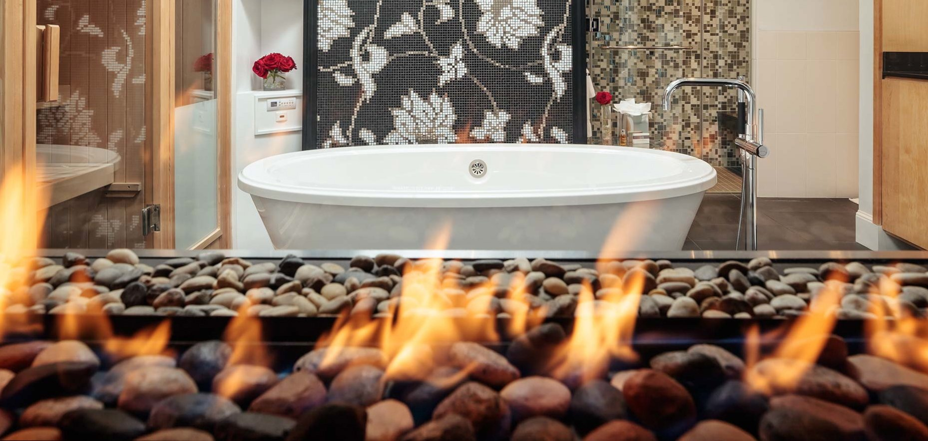 The ultimate of luxury; Royal Dutch Suite with 800 square feet of living space, 2 fireplaces, deck, 3 televisions, rainshower, steamshower, airbath and sauna. The best in Maine
