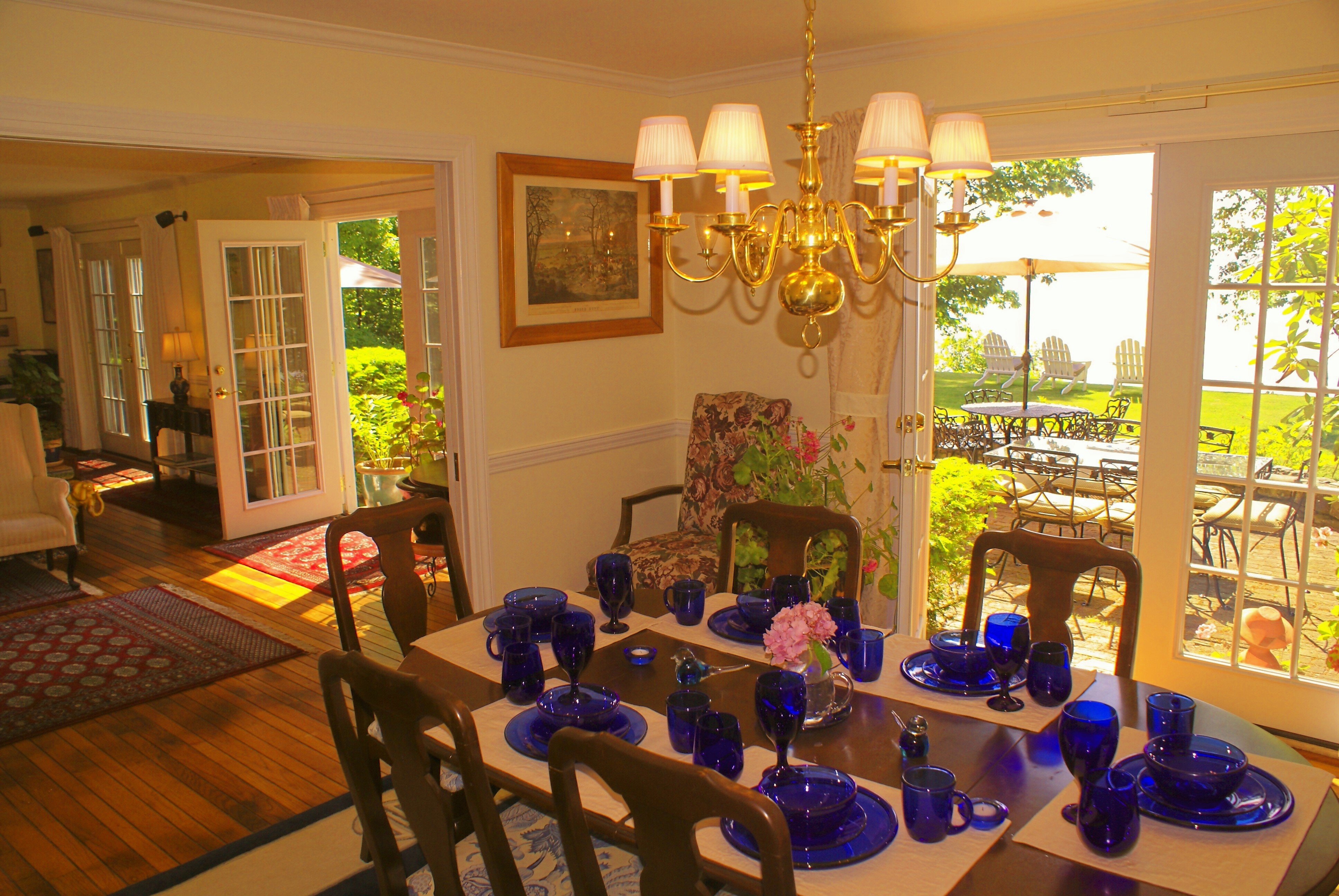 Formal dining room. Ocean view. French door to brick patio and outside dining. Brass appointments. Stobart art. 200-year old English hunting prints. Antiques. Formal place settings, 3 collections of china. Seats 8, plus 6.