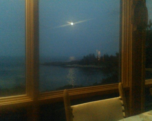 Moonrise over Fox Island from the dining table.