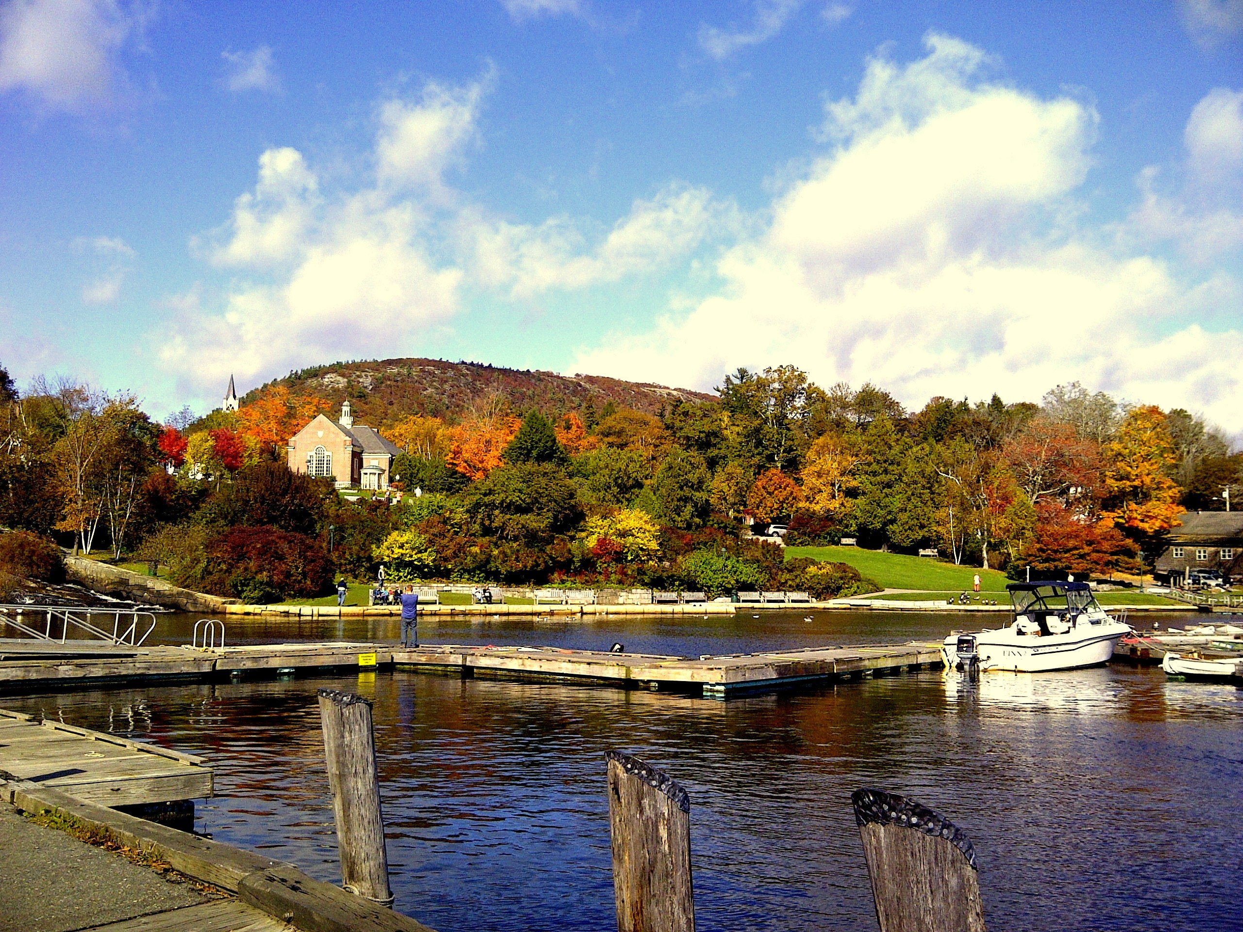 Camden Harbor in fall looking up at the top of Mt. Battie just 3 blocks from the Inns at Blackberry Common