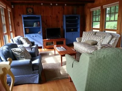 First Light Cottage - Sitting room w/TV, water views.
