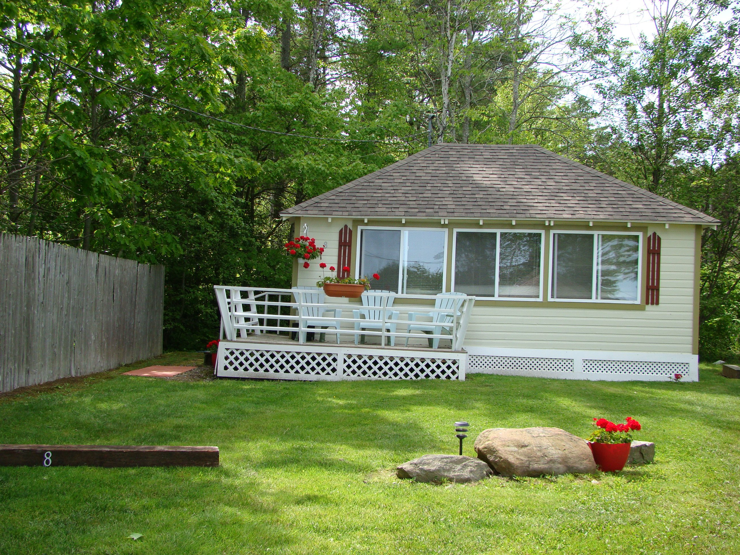 Cottage 8 - two bedroom cottage with full bed and bunk beds, kitchenette, deck