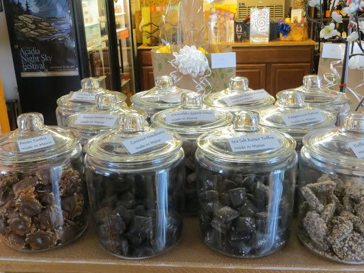 Jars of handmade chocolates and candy at the Black Sheep Wine and Beer Store,by the coast in Harpswell,Maine.