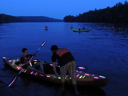 The glow stick river run makes for a visually compelling evening on the water.