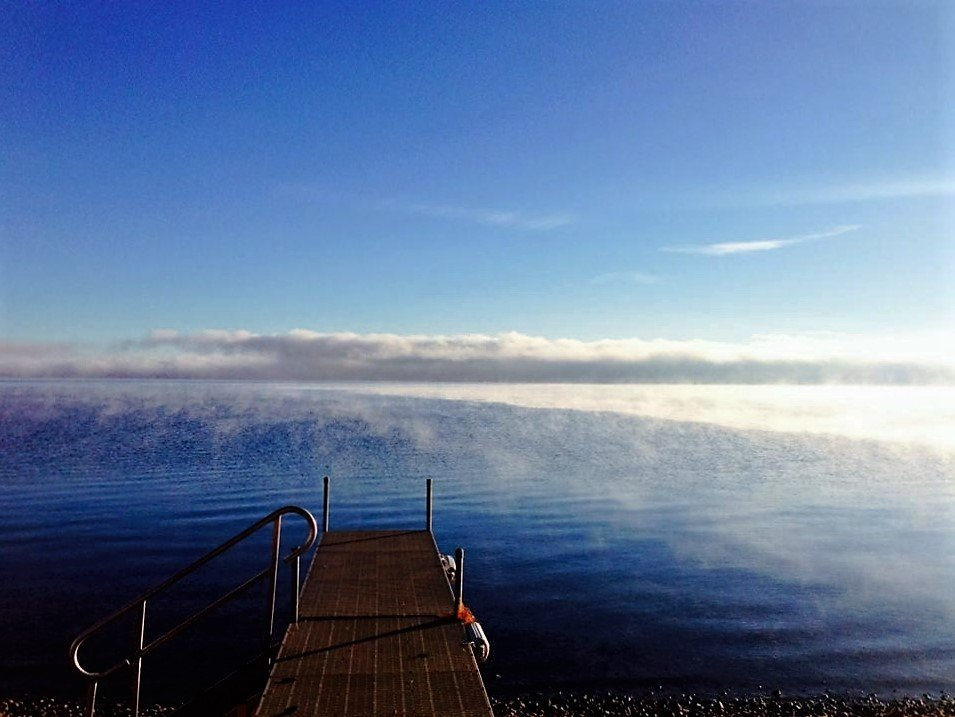 Private dock with stairs into water & sea smoke