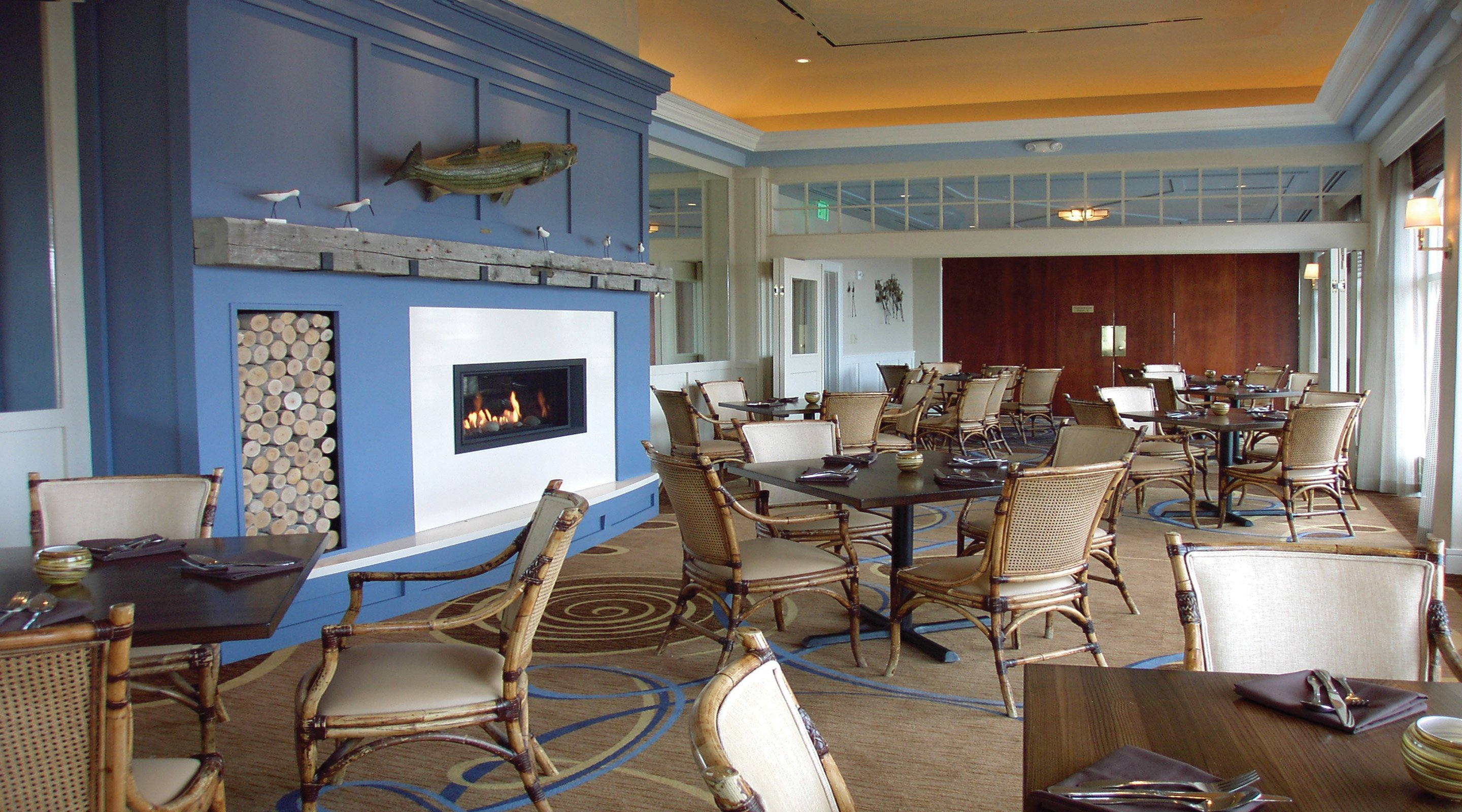 An overview of Sandpipers. It features a rustic New England gas fireplace.