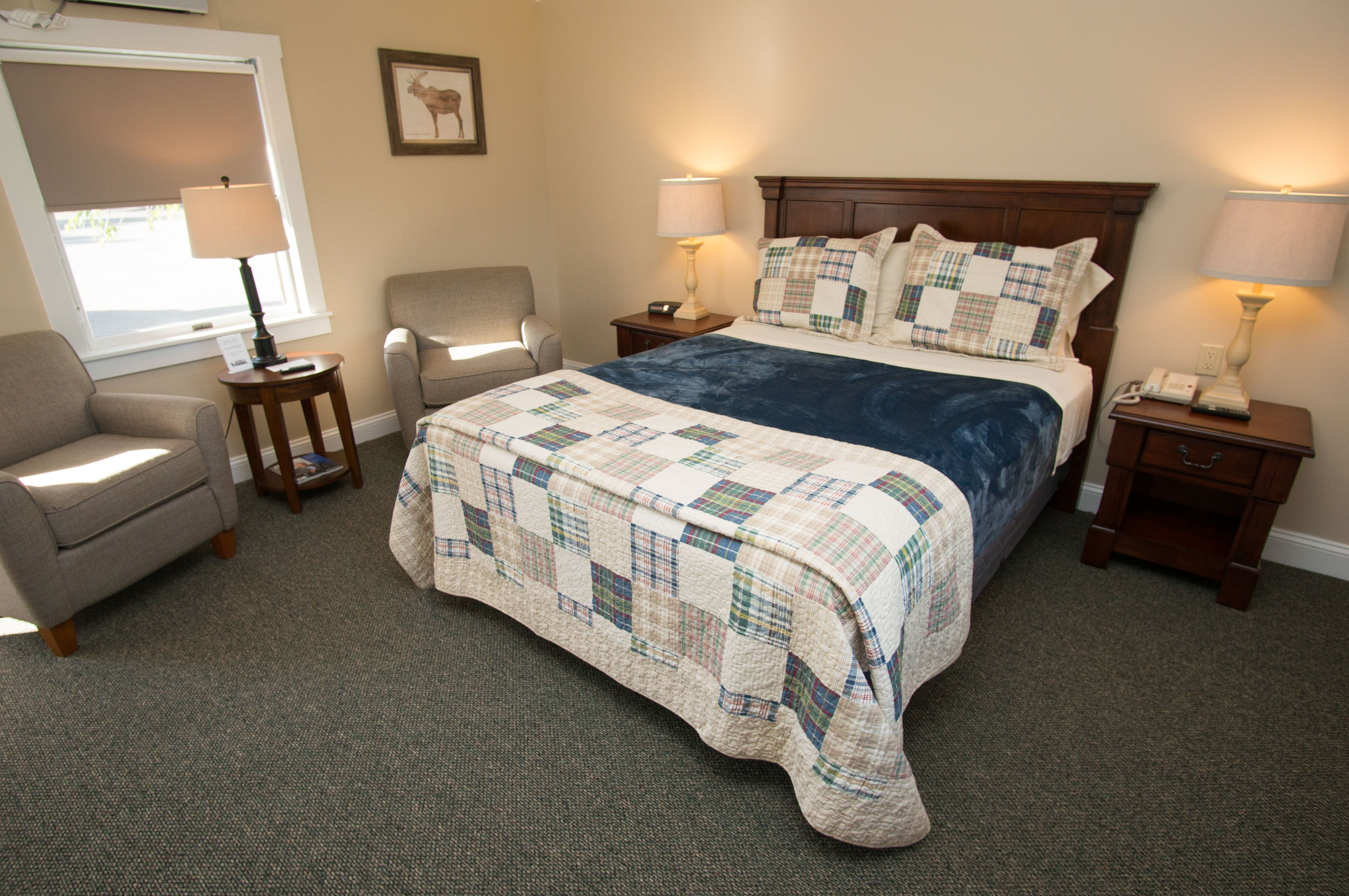 Interior of a Waterview Queen room in our Haley Pond Lodge