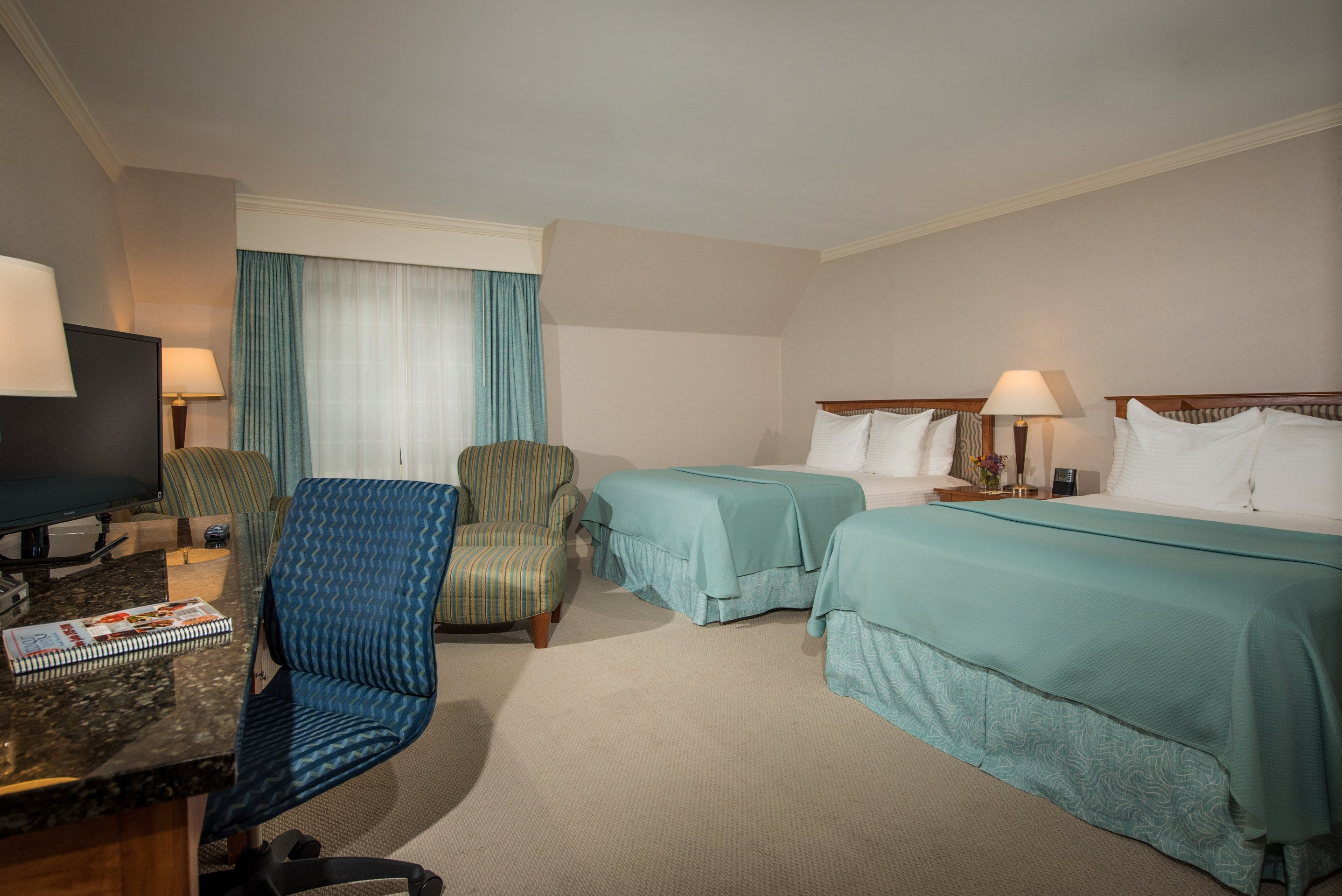 Pamper Yourself in Premium Style in our Two Queen Premium Room