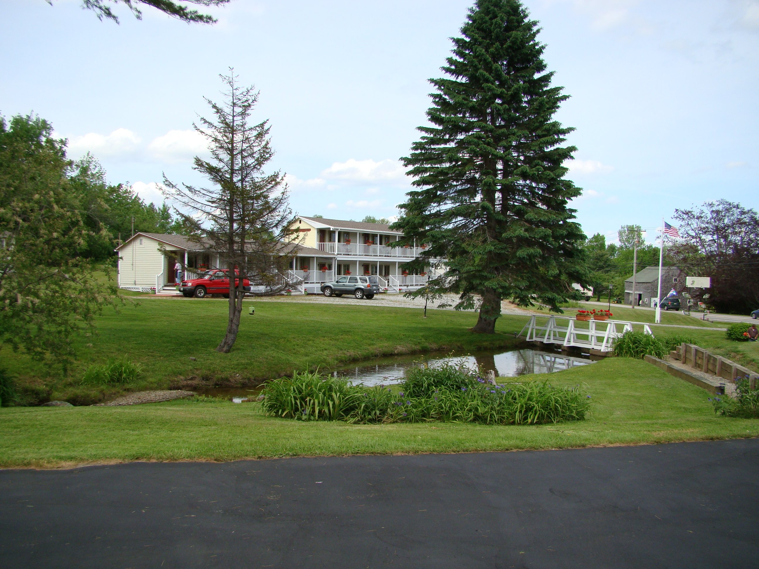 Motel as seen across our pond/stream and park-like property