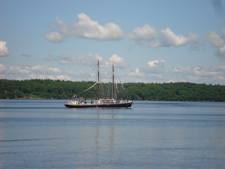 Tall Ship Sailing Past White Rocks