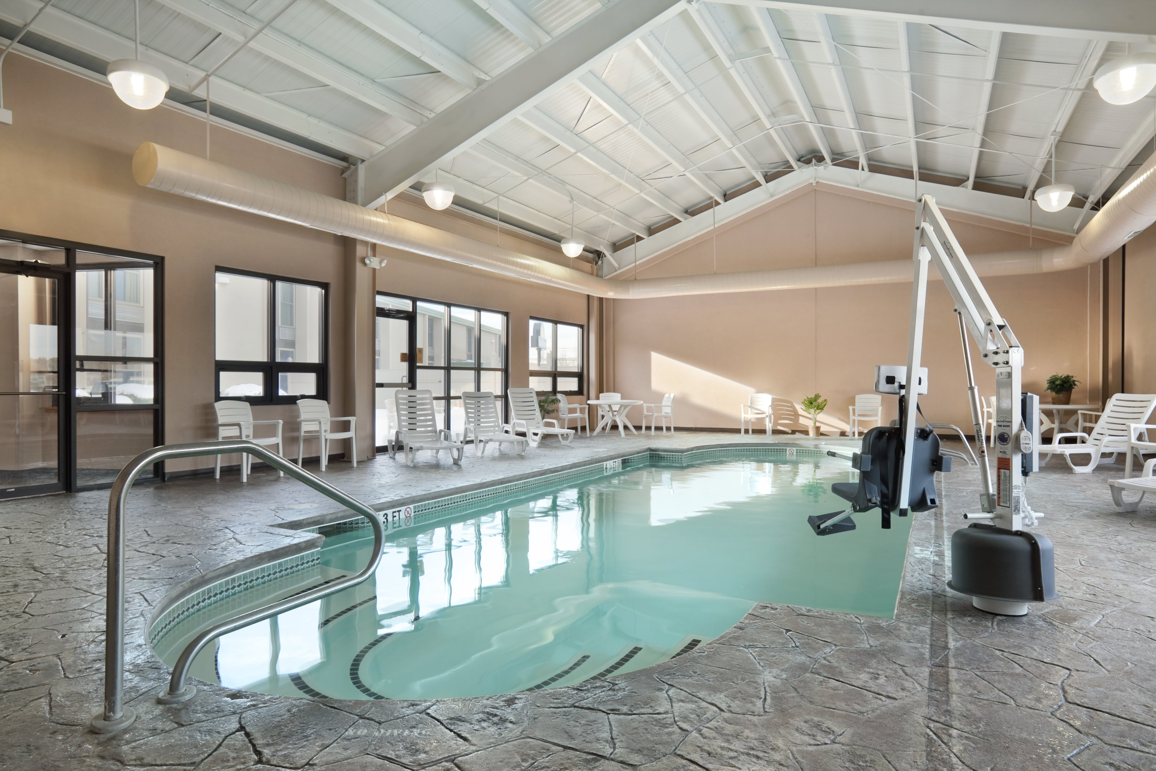 Indoor heated pool with lift chair