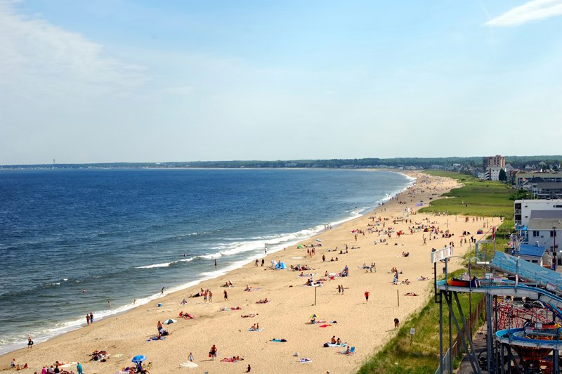 A shot of the Old Orchard Beach during a warm summer day.