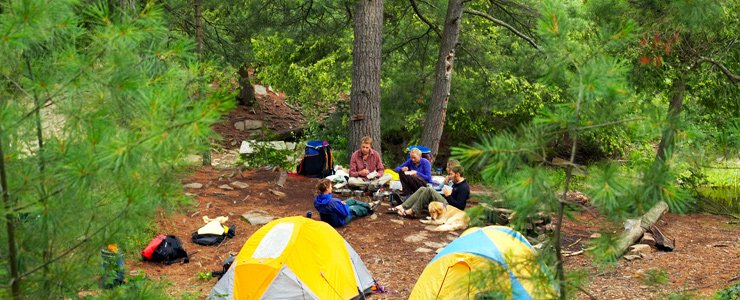 A group enjoying camping in the wilderness in Maine.