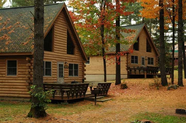 Return to comfortable, well-appointed log cabins after your day of hunting